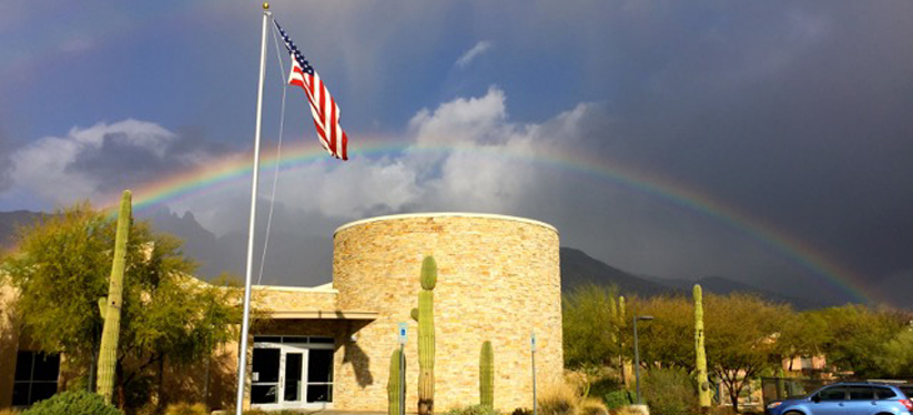 Valley View Early Learning Center building with rainbow in background