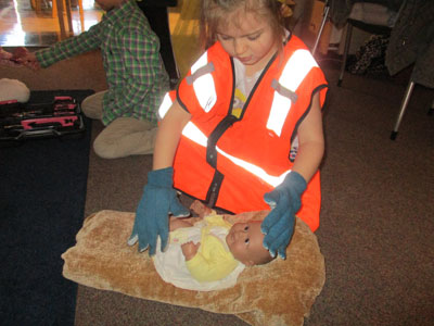 Students pretend play - construction worker with baby doll