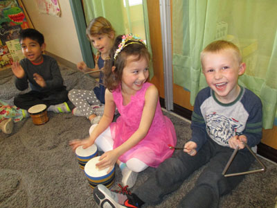 Four students with musical instruments