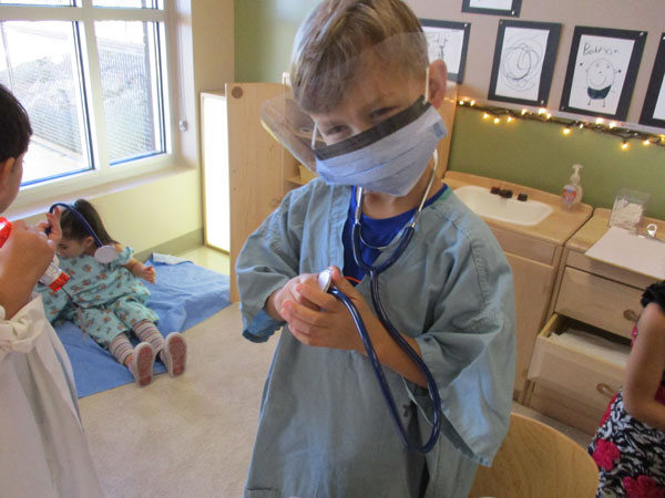 Students pretend healthcare play