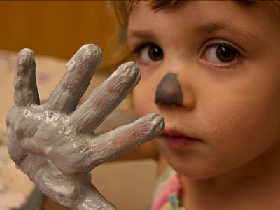 Student with paint on hand